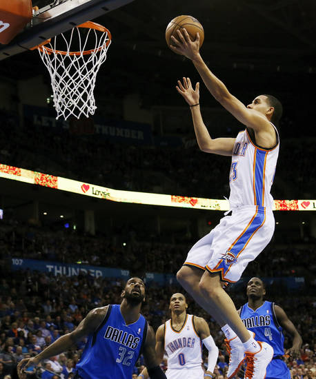 Oklahoma City's Kevin Martin (23) takes a shot as Russell Westbrook (0) along with Dallas' O.J. Mayo (32) and Darren Collison (4) look on during an NBA basketball game between the Oklahoma City Thunder and the Dallas Mavericks at Chesapeake Energy Arena in Oklahoma City, Monday, Feb. 4, 2013. Photo by Nate Billings, The Oklahoman
