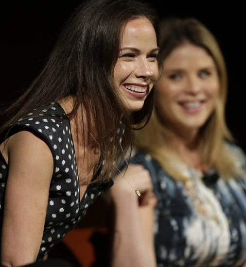 Barbara Pierce Bush, left, laughs with her sister Jenna Bush Hager, right,as they take part in the Enduring Legacies of America�s First Ladies conference Thursday, Nov. 15, 2012, in Austin, Texas. The children of three presidents discussed life in the White House as part of a conference on first ladies at the Lyndon B. Johnson Presidential Library. (AP Photo/David J. Phillip)