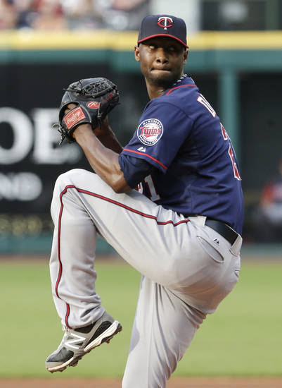 Minnesota Twins starting pitcher Samuel Deduno delivers a pitch in the first inning of a baseball game against the Cleveland Indians, Friday, June 21, 2013, in Cleveland. (AP Photo/Tony Dejak)