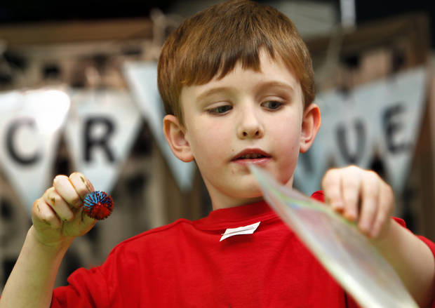 Jack Bushnell, 6, paints makes a painting in a bag during the Afterschool Special at the Norman Public Library  on Wednesday, Jan. 16, 2013 in Norman, Okla.  Photo by Steve Sisney, The Oklahoman