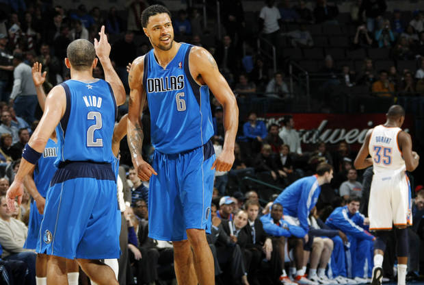 Jason Kidd (2) and Tyson Chandler (6) of Dallas celebrate while Kevin Durant (35) of Oklahoma City leaves the floor as time expires in the NBA basketball game between the Dallas Mavericks and the Oklahoma City Thunder at the Oklahoma City Arena in Oklahoma City, Monday, Dec. 27, 2010. Dallas won, 103-93. Photo by Nate Billings, The Oklahoman