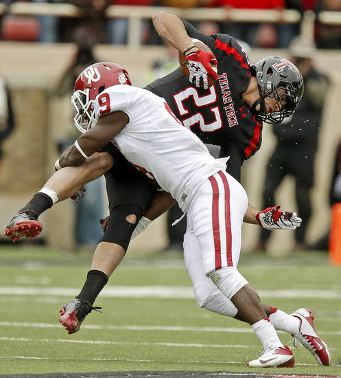 Oklahoma's Gabe Lynn (9) brings down Texas Tech's Jace Amaro (22) during a college football game between the University of Oklahoma (OU) and Texas Tech University at Jones AT&T Stadium in Lubbock, Texas, Saturday, Oct. 6, 2012. Oklahoma won 41-20. Photo by Bryan Terry, The Oklahoman