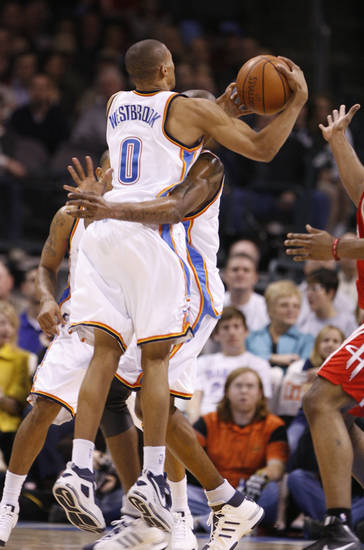 Russell Westbrook colides with Joe Smith on a rebound in the first half as the Oklahoma City Thunder plays the Houston Rockets at the Ford Center in Oklahoma City, Okla. on Friday, January 9, 2009. 