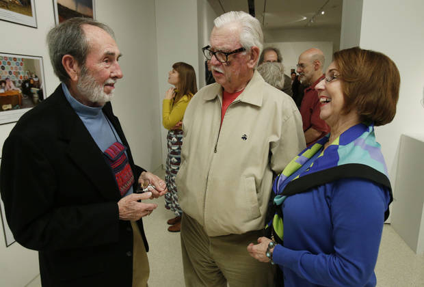 Arn Henderson, left, visits with Gary and Debby Williams at the opening reception for the 99th annual School of Art and Art History Student Exhibition at the University of Oklahoma. PHOTO BY STEVE SISNEY, THE OKLAHOMAN <strong>STEVE SISNEY</strong>