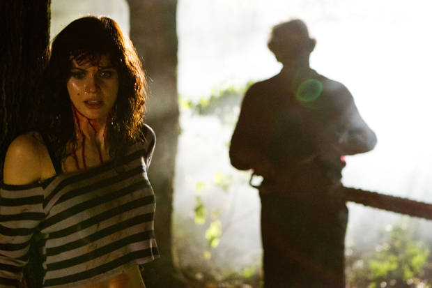 "This undated publicity film image from Lionsgate shows Alexandra Daddario, left, as Heather Miller in a scene from ""Texas Chainsaw 3-D,"" releasing in theaters on Friday, January 4, 2013.  (AP Photo/Lionsgate, Justin Lubin)"