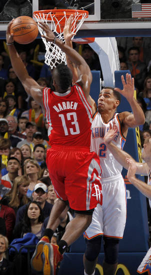 Oklahoma City 's Thabo Sefolosha (2) defends on Houston's James Harden (13) during the NBA basketball game between the Houston Rockets and the Oklahoma City Thunder at the Chesapeake Energy Arena on Wednesday, Nov. 28, 2012, in Oklahoma City, Okla.   Photo by Chris Landsberger, The Oklahoman