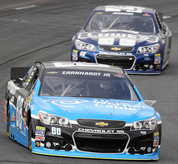 Dale Earnhardt Jr., leads Jimmie Johnson during practice for Sunday's NASCAR Sprint Cup series auto race at New Hampshire Motor Speedway, Saturday, Sept. 21, 2013, in Loudon, N.H. (AP Photo/Jim Cole)