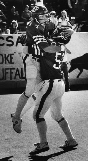 Oklahoma State's Houston Nutt, at left, celebrates with Kevin Bennitt after a 19-yard run against Colorado on Saturday, November 8, 1980, in Stillwater, Okla.  Photo by Doug Hoke, The Oklahoman.