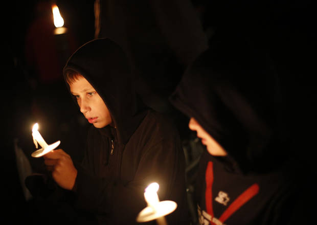 Sebastian Hayes, 8, and Brison Ready, 8, hold candles during a candlelight vigil in Edmond in honor of Mental Illness Awareness Week. PHOTO BY GARETT FISBECK, THE OKLAHOMAN <strong>Garett Fisbeck - THE OKLAHOMAN</strong>