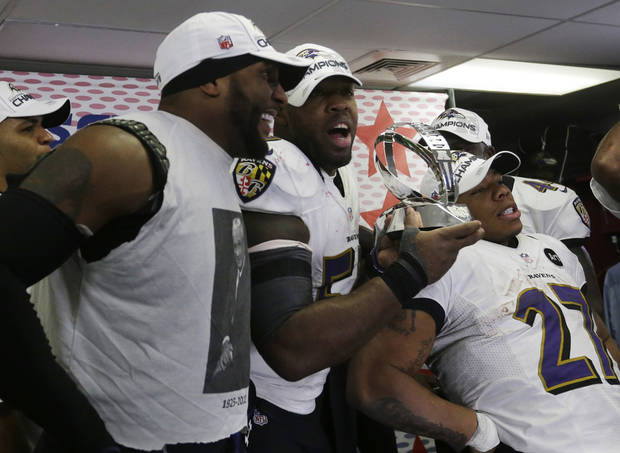 From left, Baltimore Ravens inside linebacker Ray Lewis, Terrell Suggs and Ray Rice celebrate after the NFL football AFC Championship football game against the New England Patriots in Foxborough, Mass., Sunday, Jan. 20, 2013. The Ravens defeated the Patriots, 28-13, to advance to Super Bowl XLVII. (AP Photo/Elise Amendola)