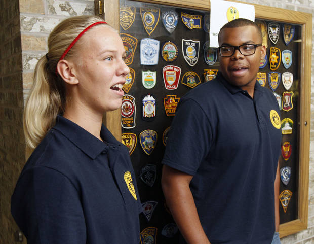 Students Bailey Harper and Christopher Plunkett  discuss their experiences as they and other students take part in the Oklahoma City Student Police Academy. Photo by Paul Hellstern, The Oklahoman <strong>PAUL HELLSTERN - Oklahoman</strong>