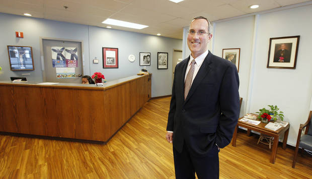 Patrick Raglow, the new executive director of Catholic Charities of Oklahoma City, stands in the lobby at the organization's office.  <strong>PAUL B. SOUTHERLAND - PAUL B. SOUTHERLAND</strong>