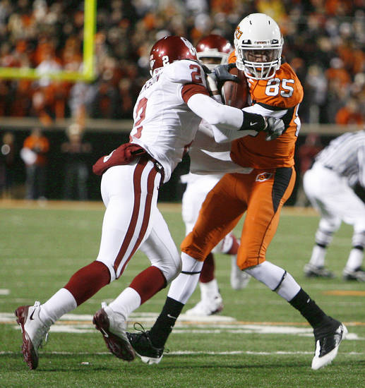 OSU's Damian Davis is hit by OU's Brian Jackson during the first half of Bedlam at Boone Pickens Stadium on Saturday in Stillwater. PHOTO BY NATE BILLINGS, THE OKLAHOMAN
