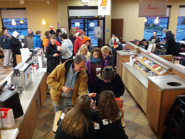 About 100 people showed up to camp outside Oklahoma City�s newest Chick-fil-A location at Interstate 40 and MacArthur for a chance to win free meals for a year. Here, they are let inside to register before heading back outside to set up their tents.