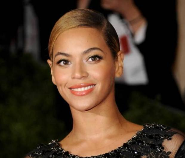 his May 7, 2012 file photo shows Beyonce Knowles at the Metropolitan Museum of Art Costume Institute gala benefit, celebrating Elsa Schiaparelli and Miuccia Prada in New York. President Obama released an official playlist through the digital music service Spotify on Thursday, Jan. 18, 2013. The list includes songs by Beyonce, Stevie Wonder, John Legend, Usher, fun. and other acts set to perform during various inauguration events. (AP Photo/Evan Agostini, File)