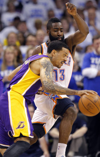 Oklahoma City's James Harden defends on Los Angeles' Matt Barnes during Game 2 in the second round of the NBA playoffs between the Oklahoma City Thunder and the L.A. Lakers at Chesapeake Energy Arena on Wednesday,  May 16, 2012, in Oklahoma City, Oklahoma. Photo by Chris Landsberger, The Oklahoman