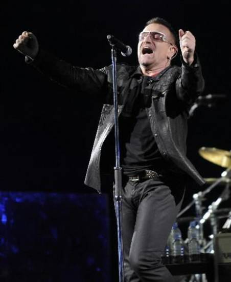 In this Oct. 25, 2009 file photo,  Bono of the Irish rock band U2 performs during their 360 world tour stop at the Rose Bowl in Pasadena, Calif. (AP Photo/Chris Pizzello)