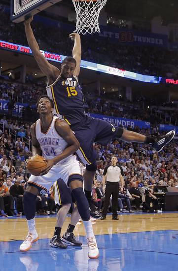 Oklahoma City Thunder&#039;s Hasheem Thabeet (34) is fouled by Utah Jazz&#039;s Derrick Favors (15) during the NBA basketball game between the Oklahoma City Thunder and the Utah Jazz at Chesapeake Energy Arena on Wednesday, March 13, 2013, in Oklahoma City, Okla. Photo by Chris Landsberger, The Oklahoman
