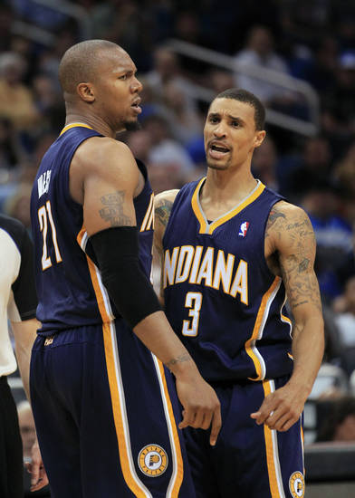   Indiana Pacers&#039; David West (21) and George Hill (3) shout encouragement to each other during the second half of Game 4 of an NBA first-round playoff basketball series against the Orlando Magic, Saturday, May 5, 2012, in Orlando, Fla. Indiana won in overtime 101-99.(AP Photo/John Raoux)  