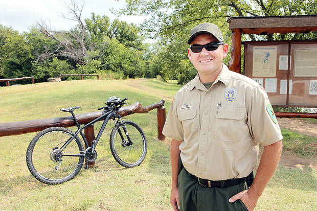 Roman Nose State Park Manager Travis Lindley talks about the two mountain bikes they use to patrol the trails that were perches with funds eased by Race a Rail, Monday, September 16, 2013.  Photo by David McDaniel, The Oklahoman