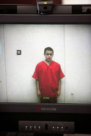 Tristan Ryan Owen, 15, looks down Friday during his video arraignment from the Oklahoma County jail. <strong>PAUL B. SOUTHERLAND - PAUL B. SOUTHERLAND</strong>