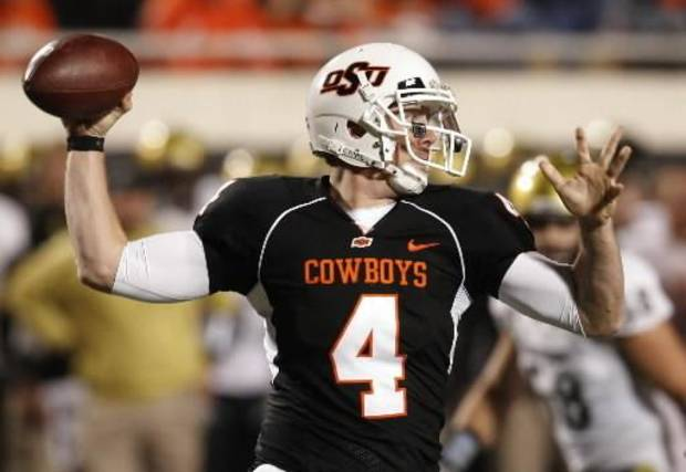 Oklahoma State's Brandon Weeden passes against  Colorado in the third quarter of an NCAA college football game in Stillwater, Okla., Thursday, Nov. 19, 2009. Oklahoma State won the game 31-28. AP Photo