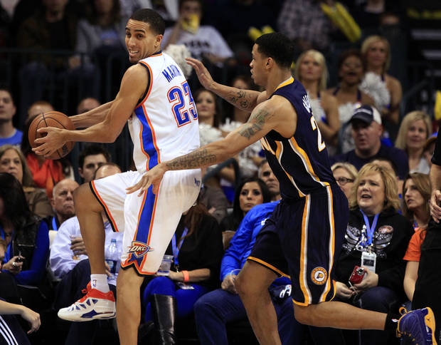 Oklahoma City's Kevin Martin (23) tries to save an out of bounds ball as Indiana's Gerald Green (25) defends during the NBA game between the Indiana Pacers and the Oklahoma City Thunder at the Chesapeake Energy Arena   Sunday,Dec. 9, 2012. Photo by Sarah Phipps, The Oklahoman