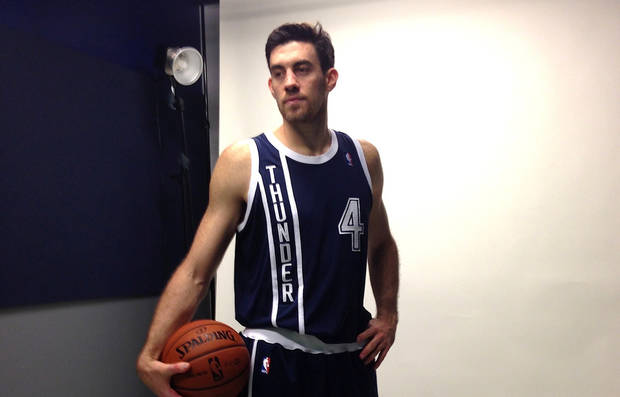 Nick Collison poses in the Thunder�s new alternate jersey, which will make its debut in Friday night�s home game against Detroit. The jersey can be ordered on-line starting Thursday at 4 p.m. Photo provided by Oklahoma City Thunder.