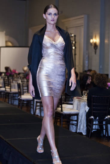 Model Christine B. is wearing a rose gold tight dress by Herve Leger at the Liberte runway show to benefit cystic fibrosis, hosted by Merrill Lynch Wealth Management. Photo provided. <strong></strong>