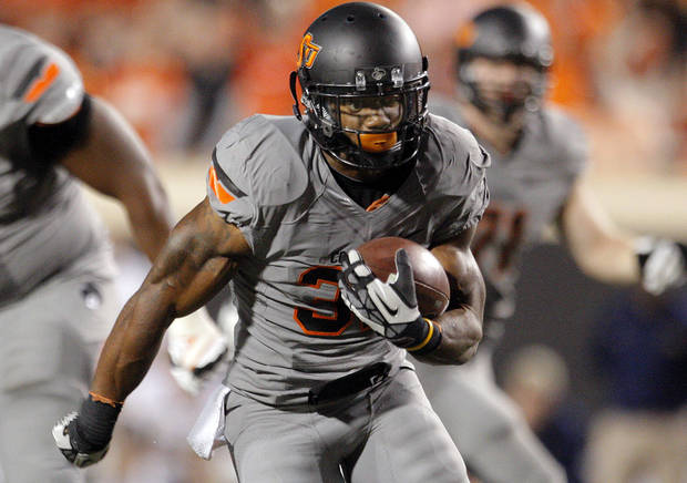 Oklahoma State&#039;s Jeremy Smith (31) rushes for a touchdown in the fourth quarter during a college football game between Oklahoma State University (OSU) and the West Virginia University at Boone Pickens Stadium in Stillwater, Okla., Saturday, Nov. 10, 2012. OSU won 55-34. Photo by Sarah Phipps, The Oklahoman
