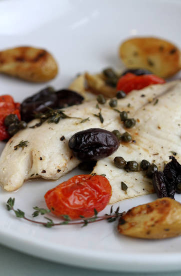 Mild-flavored tilapia is a forgiving ingredient and goes well with kalamata olives, tomatoes and fingerling potatoes. (Jessica J. Trevino/Detroit Free Press/MCT)