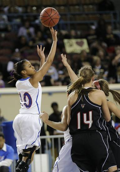 Millwood's Teanna Reid (10) shoots the ball over Verdigris' Courtney Risenhoover (14) during the 3A girls quarterfinals game between Millwood High School and Verdigris High School at the State Fair Arena on Thursday, March 7, 2013, in Oklahoma City, Okla. Photo by Chris Landsberger, The Oklahoman