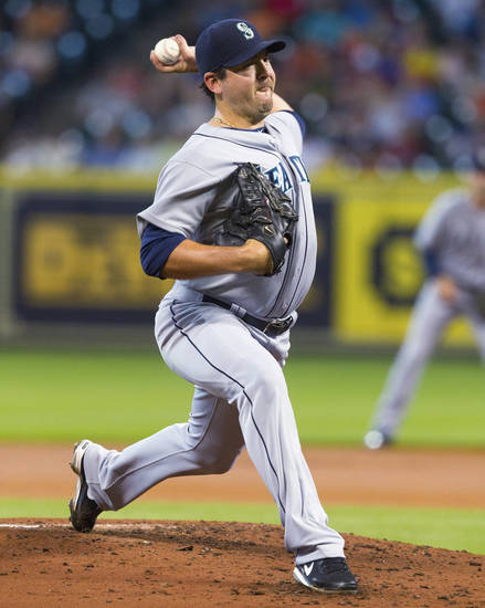 Seattle Mariners starting pitcher Joe Saunders throws to a Houston Astros batter in the first inning of a baseball game Friday, July 19, 2013, in Houston. (AP Photo/Bob Levey)