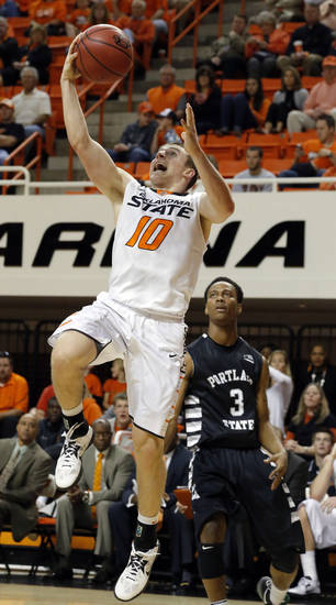 Oklahoma State's Phil Forte (10) Portland State's Dre Winston Jr. (3) during the college basketball game between Oklahoma State University and Portland State, Sunday,Nov. 25, 2012. Photo by Sarah Phipps, The Oklahoman