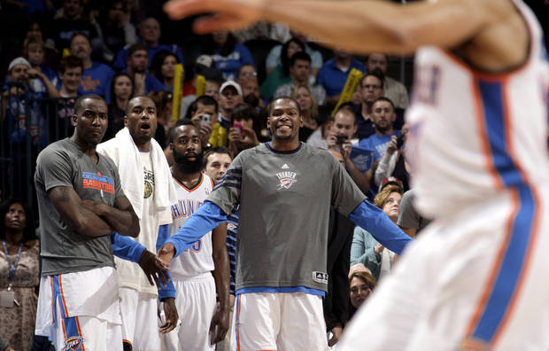 Oklahoma City's Kendrick Perkins (5), Serge Ibaka (9), James Harden (13) and Kevin Durant (35) watch the final second of the NBA basketball game between the Oklahoma City Thunder and the Toronto Raptors at Chesapeake Energy Arena in Oklahoma City, Sunday, April 8, 2012. Photo by Sarah Phipps, The Oklahoman.