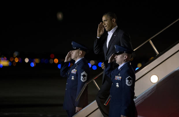 President Barack Obama salutes as he steps off Air Force One after arriving at West Palm Beach International Airport on Friday, Feb. 15, 2013, in West Palm Beach, Fla. President Obama is spending the weekend in Palm City, Fla.  (AP Photo/Evan Vucci)