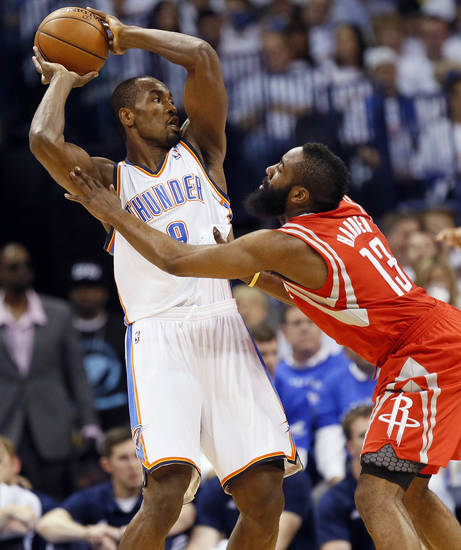 Oklahoma City's Serge Ibaka (9) keeps the ball away from Houston's James Harden (13) during Game 2 in the first round of the NBA playoffs between the Oklahoma City Thunder and the Houston Rockets at Chesapeake Energy Arena in Oklahoma City, Wednesday, April 24, 2013. Photo by Nate Billings, The Oklahoman