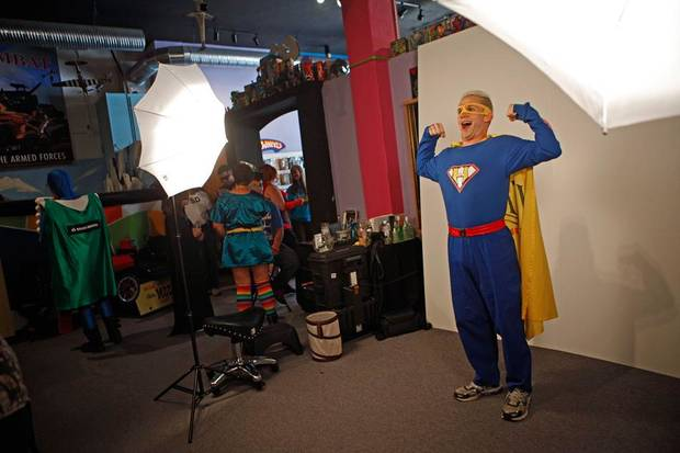 Dressed as Heroman, The Noble Superhero, Keith Thomas of Noble, poses for a photo during International Superhero Day in Pauls Valley, Okla., Saturday, August 4, 2012.