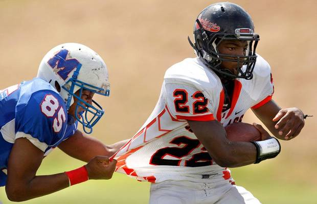 Millwood's Quincy Dotson tries to bring down Douglass' Chris High during the high school football game between Millwood and Douglass at Millwood High School in Oklahoma City, Saturday, Sept. 10, 2011. Photo by Sarah Phipps, The Oklahoman