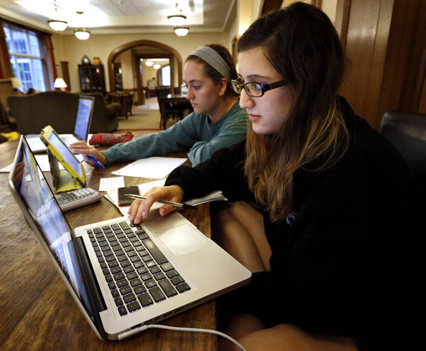 Engineering students Sarah Barnes, left from Lawton, and Sarah Yung, Dallas, study on a computer Friday in the Price College of Business building at the University of Oklahoma. Photo by Steve Sisney, The Oklahoman <strong>STEVE SISNEY</strong>