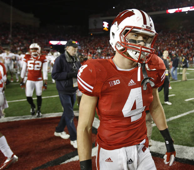 Wisconsin's Jared Abbrederis walks off the field after losing 21-14 in overtime to Ohio State in an NCAA college football game Saturday, Nov. 17, 2012, in Madison, Wis. (AP Photo/Andy Manis)