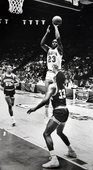 Former OU basketball player Wayman Tisdale. Record-setting shot: Wayman Tisdale pumps in the basket which made him the all-time scoring leader in the Big Eight. Staff photo by Doug Hoke. Photo taken 1/12/1985, Photo published 1/14/1985 in The Daily Oklahoman. ORG XMIT: KOD