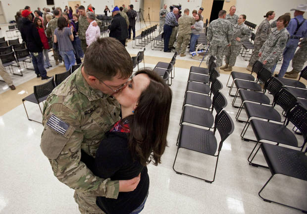 Spc Adam Nicely, Wagoner, is greeted by his girl friend Shae Bellis, 20, as members of the Oklahoma National Guard are welcomed by family and friends on their return from Afghanistan on Thursday, Jan. 12, 2012, in Norman, Okla.  