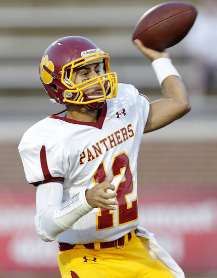 Putnam City North&#039;s John Simon throws a pass against Edmond North during a high school football game at Wantland Stadium in Edmond, Okla., Friday, September 21, 2012. Photo by Bryan Terry, The Oklahoman