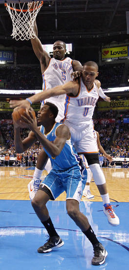 Oklahoma City Thunder's Kendrick Perkins (5) and Russell Westbrook (0) defend on New Orleans Hornets' Al-Farouq Aminu (0) during the NBA basketball game between the Oklahoma CIty Thunder and the New Orleans Hornets at the Chesapeake Energy Arena on Wednesday, Dec. 12, 2012, in Oklahoma City, Okla.   Photo by Chris Landsberger, The Oklahoman