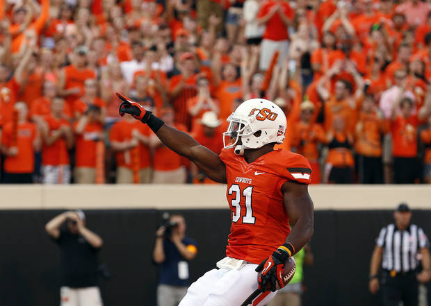 CELEBRATION: Oklahoma State's Jeremy Smith (31) celebrates a touchdown during a college football game between Oklahoma State University (OSU) and Savannah State University at Boone Pickens Stadium in Stillwater, Okla., Saturday, Sept. 1, 2012. Photo by Sarah Phipps, The Oklahoman