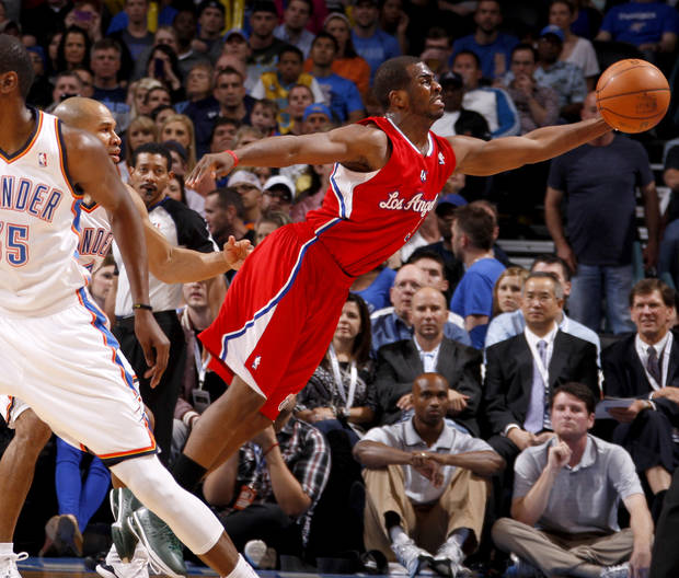 Los Angeles' Chris Paul (3) leaps for the ball in front of Oklahoma City's Derek Fisher (37) during the NBA basketball game between the Oklahoma City Thunder and the Los Angeles Clippers at Chesapeake Energy Arena in Oklahoma City, Wednesday, April 11, 2012. Photo by Bryan Terry, The Oklahoman