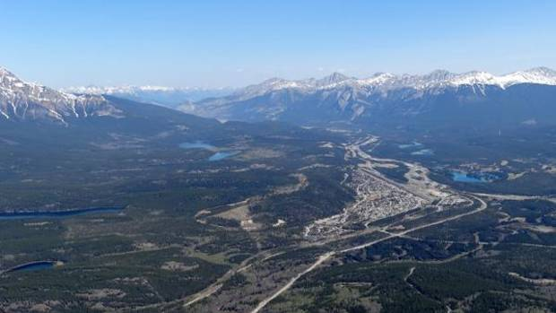 A view of Jasper and surrounding lakes and mountains