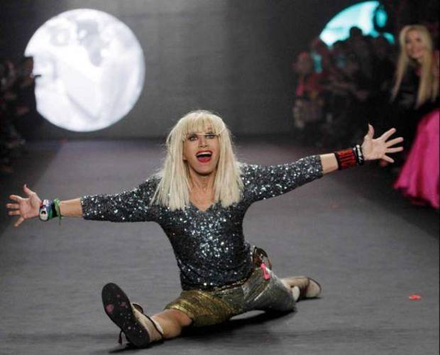 Betsey Johnson does the splits on the runway after her fall 2012 runway show in New York. AP PHOTO
