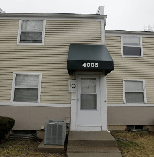 A townhouse where police found a 17-year-old boy handcuffed to a post in the basement is pictured Thursday, Feb. 7, 2013, in Kansas City, Mo. On Monday, police rescued the boy, who said he had been kept in the basement since September, after receiving a tip from a neighbor. (AP Photo/Charlie Riedel)